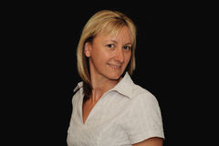 Lächelnde blonde Frau Lizenzfreie Stockbilder