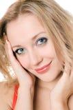 Lächelnde blonde Frau der Junge Lizenzfreie Stockfotografie