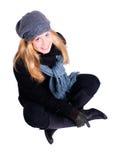 Lächelnde blonde Frau im Winter kleidet über Weiß Lizenzfreies Stockbild
