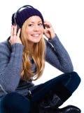 Lächelnde blonde Frau mit Kopfhörern Lizenzfreie Stockfotos