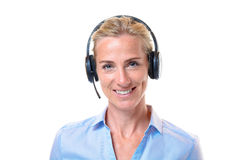 Lächelnde blonde Frau mit Telefonkopfhörer Stockfotografie