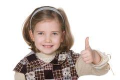 Lächelnde blonde Mädchenholding ihr Daumen oben Stockbild