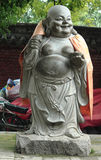 Lächelnde Buddha-Statue Stockfotografie