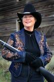 Lächelnde Dame Gunman Stockfotografie