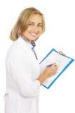 Lächelnde Frau bei der Arbeit Lizenzfreie Stockbilder