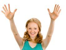 Lächelnde Frau des Porträts, die zehn Finger zeigt Stockfotografie