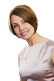 Lächelnde Frau getrennt Lizenzfreies Stockfoto