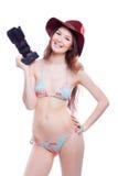 Lächelnde Frau mit Berufskamera Stockbilder