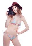 Lächelnde Frau mit Berufskamera Stockfotografie