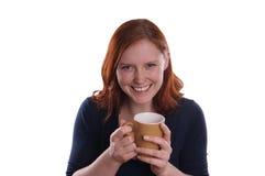 Lächelnde Frau mit Cup oder Becher Stockfoto