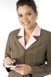 Lächelnde Frau mit PDA Lizenzfreies Stockfoto
