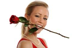 Lächelnde Frau mit Rose Stockbilder