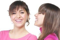 Lächelnde Frauen im Rosa stockbild