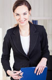 Lächelnde Geschäftsfrau Stockfotografie