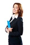 Lächelnde Geschäftsfrau, die Notizbuch und Stift hält Stockfotos