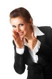 Lächelnde Geschäftsfrau, die sich Daumen zeigt Stockfoto