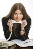 Lächelnde Geschäftsfrau mit Telefonempfänger Stockbild