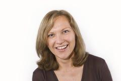 Lächelnde glückliche Frau Stockbild