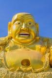 Lächelnde goldene Buddha-Statue Lizenzfreies Stockfoto