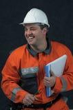 Lächelnde Grubenarbeitskraft mit Datei lizenzfreies stockbild