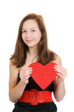 Lächelnde Jugendliche, die Valentinsgrußinneres anhält lizenzfreie stockfotos