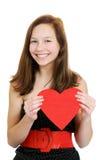 Lächelnde Jugendliche, die Valentinsgrußinneres anhält lizenzfreies stockbild