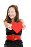 Lächelnde Jugendliche, die Valentinsgrußinneres anhält Stockfotos