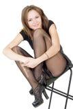 Lächelnde junge Frau in den heftigen Strümpfen Stockfotos