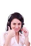 Lächelnde junge Frau des Kundenkontaktcenters mit einem Kopfhörer Lizenzfreie Stockfotos