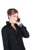 Lächelnde junge Frau mit Mobiltelefon Stockfotografie