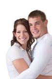 Lächelnde junge Paare Stockbilder
