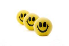 Lächelnde Kugeln in der vollkommenen Ordnung Stockfotos
