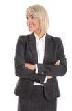 Lächelnde lokalisierte Geschäftsfrau, die seitlich zum Text schaut Stockfoto