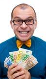 Lächelnde Mannholdinghandvoll Geld Stockfotografie