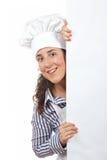 Lächelnde neugierige Kochfrau Stockfoto