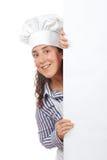Lächelnde neugierige Kochfrau Lizenzfreie Stockbilder