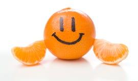 Lächelnde orange Mandarinen- oder Tangerinefrucht Stockbilder
