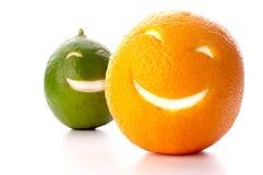 Lächelnde Orange und Kalk Stockfotografie