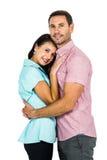 Lächelnde Paare, die Kamera umarmen und betrachten Stockbilder