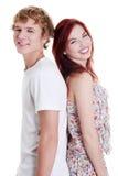 Lächelnde Paare, die zurück zu Rückseite stehen. Stockfoto