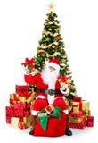 Lächelnde Sankt und Weihnachtsbaum stockbilder
