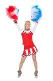 Lächelnde schöne Cheerleader mit Pompoms. Stockfotos