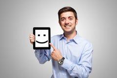 Lächelnde Tablette Stockfotografie