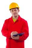 Lächelnde tragende Funktionskleidung des jungen Arbeitnehmers stockbild