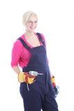 Lächelnde weibliche Arbeitskraft mit einem Bohrgerät Stockfoto