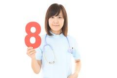 Lächelnde weibliche Krankenschwester Stockbilder