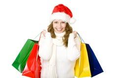 Lächelnde Weihnachtsmann-Frau, die das Weihnachtseinkaufen tut Stockbilder