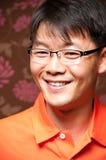 Lächelnder asiatischer Mann Stockbilder