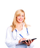 Lächelnder blonder weiblicher Doktor mit Stethoskop Lizenzfreies Stockfoto