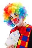 Clown, der großes Geld zeigt Stockbilder